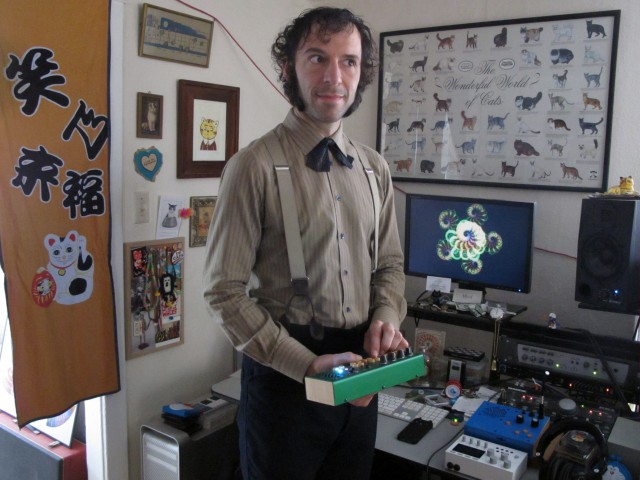 Daeelus In his home studio (holding a PocketPiano GR from Critter & Guitari)