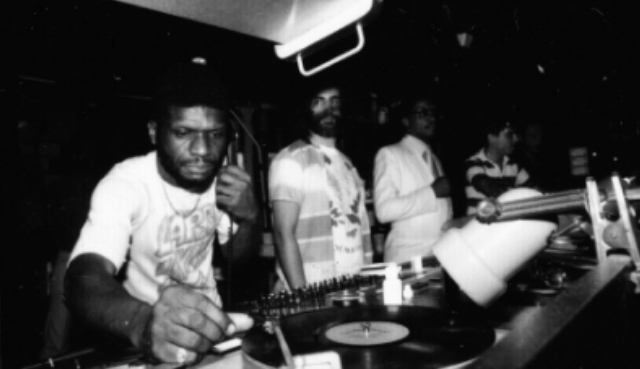 Larry Levan rocking a monophone at the Paradise Garage with David Mancuso (center) and Herbie Hancock (right). Photo credit: Gail Bruesewitz