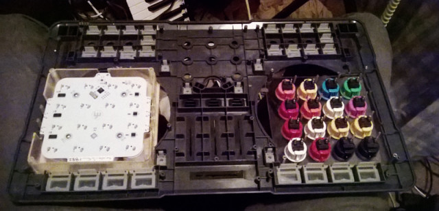 Midi Fighters mounted in the cut chassis.