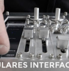 Modulares Interface B.A. is a physical medium for the iPad made up of knobs, buttons and sliders to provide precision and haptic feedback.