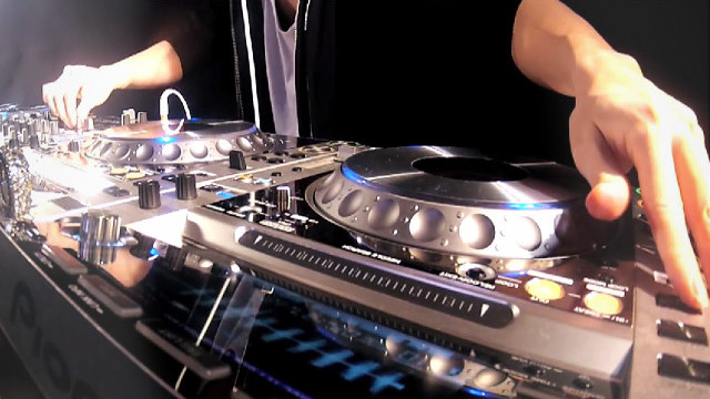 YAMATO Routine featuring 4 CDJ-2000s, Pioneer DJM 900, and a Pioneer RMX-500.